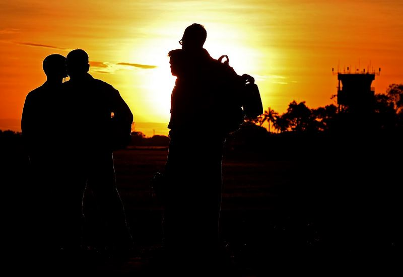 United States Marines watch the sun set over RAAF Base Tindal, in the Northern Territory, during Exercise Talisman Sabre 2015.