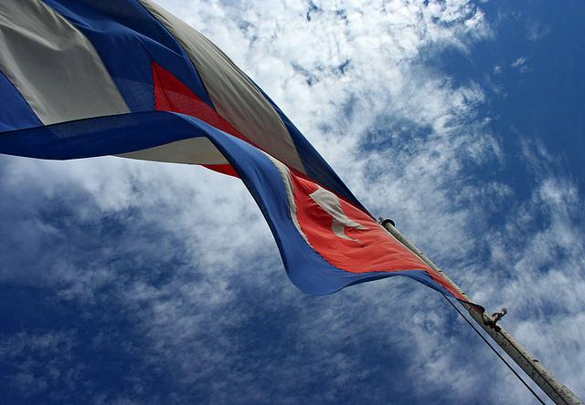 The Cuban flag is raised over Havana's embassy in Washington DC