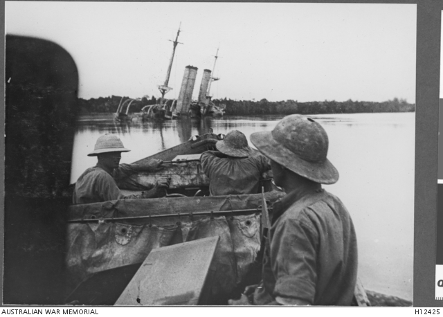 "German East Africa. July 1915. British Navy officers approaching the wreck of the German Navy cruiser SMS Konigsberg in the Rufigi River south of Dar es Salaam. The Konigsberg had taken shelter in the river in December 1914 and withstood a British blockade until finally destroyed by HMS Severn on 12 July 1915. The Australian cruiser, HMAS Pioneer, also took part in the blockade. HMAS Pioneer, dating from pre-federation years, saw ""more actual fighting and probably fired more rounds in the cause of actual hostilities than any other ship of the Australian Squadron."" (Donor Imperial War Museum SP967)"