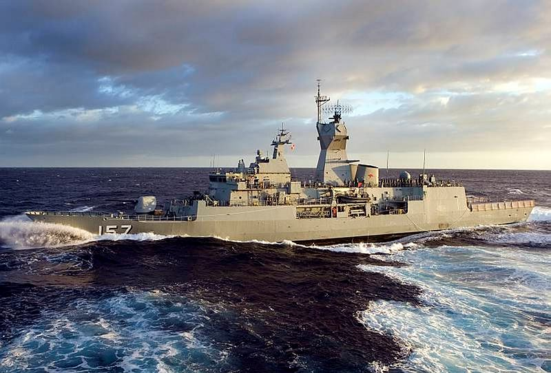 HMAS Perth in position alongside HMAS Sirius in preparation for a replenishment at sea