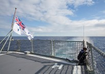 The ashes of former sailor Charles Stevenson are scattered in the ocean by Leading Seaman Maritime Logistics – Personnel Natalie Stephens of HMAS Anzac, during a small service as the ship crosses the Indian Ocean.