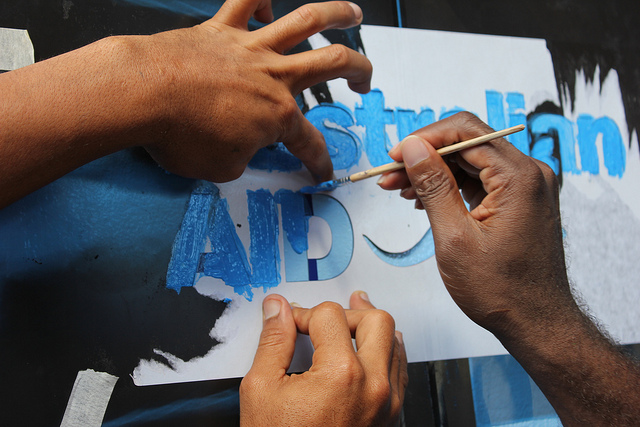 Painting the Australian Aid logo, Solomon Islands, 2012