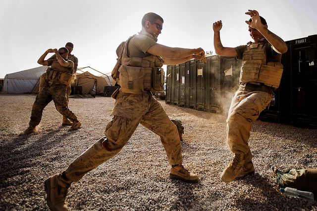 U.S. Marine Corps Lance Cpl. Ryan Turner, left, Combat Logistics Battalion (CLB) 22, 22nd Marine Expeditionary Unit, landing support specialist and native of Longcreek, S.C., counters a kick from Lance Cpl. Zack Jarvis, CLB-22 heavy equipment operator and native of Saint Peters, Mo., during martial arts training. The 22nd MEU is deployed with the Bataan Amphibious Ready Group as a theater reserve and crisis response force throughout U.S. Central Command and the U.S. 5th Fleet area of responsibility. (Marine Corps photo by Sgt. Austin Hazard/Released)