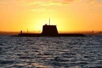HMAS Collins sails out through the channel to meet HMAS Waller and HMAS Rankin at Gage Roads at sunrise.