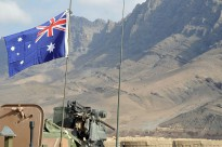 The Australian flag flies proudly above an Australian Light Armoured Vehicle parked inside an Australian and Afghan patrol base in the Baluchi Valley, Oruzgan Province.