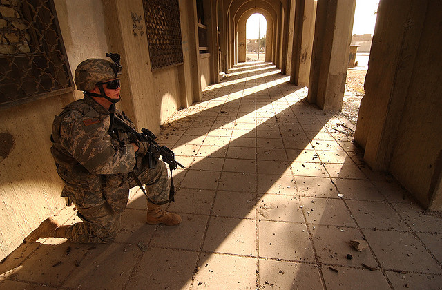 Spc. Gilad Wolbe provides security for fellow Soldiers nearby during a humanitarian mission in Baghdad on Feb. 26