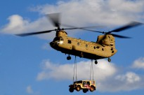 A U.S. Army Chinook Helicopter makes its landing approach, in preparation to deliver a humvee to a Forward Operating Base in Southern Afghanistan, March 4, 2010.