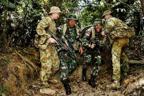 Australian Army soldiers assist Indonesian Army personnel on the Tully training area obstacle course as part of the Junior Officer Combat Instructor Training course conducted by the Australian Army's Combat Training Centre—Jungle Training Wing from 28 September to 10 October 2014.