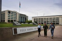 Royal Australian Air Force members Flight Lieutenant Stephanie Anderson (left), Squadron Leader Clint Huxley and Sergeant Damian Williams at the Department of Defence complex, Russell Offices, Canberra.