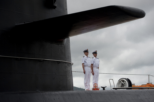 Chinese People's Liberation Army-Navy sailors stand watch on the submarine Yuan at the Zhoushan Naval Base in China on July 13, 2011
