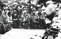 As Major General, Suharto (at right, foreground) attends funeral for assassinated generals 5 October 1965.