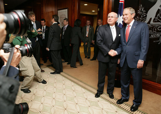 President George W. Bush and Prime Minister John Howard of Australia, shake hands as they meet for the start of a daylong visit Wednesday, Sept. 5, 2007, at the Commonwealth Parliament Offices in Sydney. White House photo by Eric Draper