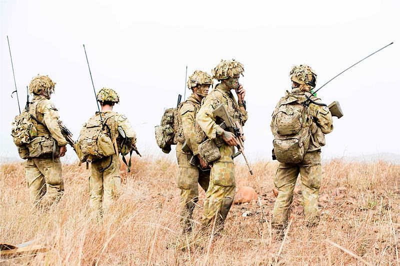 Australian Army officer Lieutenant Colonel Gavin Keating (second right), Commanding Officer, 3rd Battalion, Royal Australian Regiment, surrounded by signallers during the combined arms training activity at Townsville field training area between 1 and 18 June 2015.