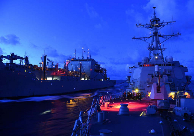 SOUTH CHINA SEA (Sept. 17, 2015) The Arleigh Burke-class guided-missile destroyer USS Lassen (DDG 82), right, receives fuel from the Military Sealift Command dry cargo and ammunition ship USNS Amelia Earhart (T-AKE 6) during an underway replenishment. Lassen is on patrol in the U.S. 7th Fleet area of responsibility in support of security and stability in the Indo-Asia-Pacific region. (U.S. Navy photo by Mass Communication Specialist 2nd Class Corey T. Jones/Released)