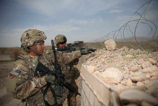 U.S. Army 1st Lt. Audrey Griffith, points out an area of interest during a force protection drill to Spc. Heidi Gerke along the perimeter of Forward Operating Base Hadrian in Deh Rawud, Afghanistan, March 18, 2013.