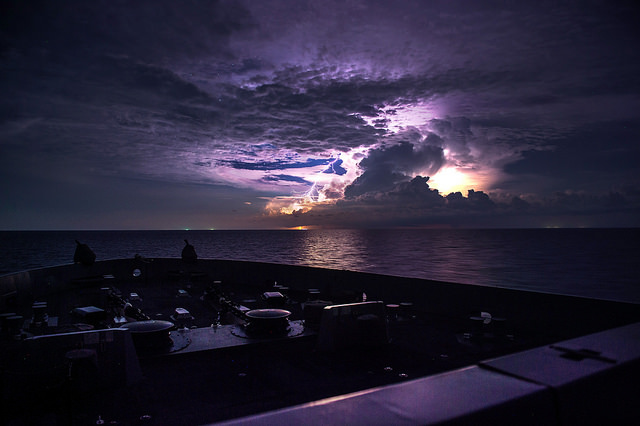 SOUTH CHINA SEA (June 13, 2015) Lightning strikes the water as San Antonio-class amphibious transport dock ship USS Anchorage (LPD 23) navigates between storms.