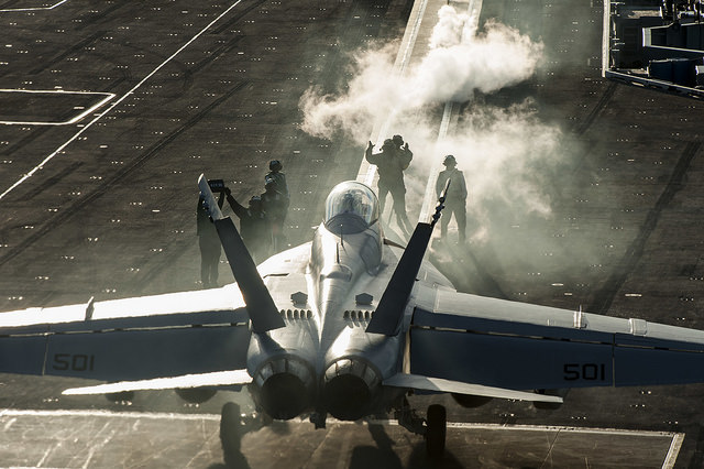 "ATLANTIC OCEAN (Nov. 16, 2015) Sailors direct an EA-18G Growler, assigned to the ""Patriots"" of Electronic Attack Squadron (VAQ) 140, on the flight deck of aircraft carrier USS Harry S. Truman (CVN 75)."