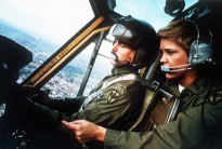 PHOTO CAPTION: A U.S. Army Ranger pilot and female crew chief conduct flight operations in a helicopter.