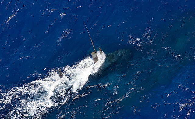 A Collins class submarine sails through the water during a weapons firing serial conducted off of the coast of Western Australia.