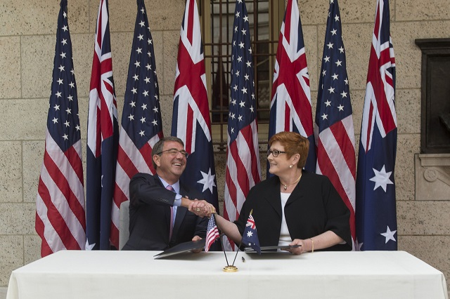 U.S. Defense Secretary Ash Carter and Australian Defense Minister Marise Payne shake hands after signing a U.S.-Australia defense statement at the Boston Public Library during the Australia-U.S. Ministerial Consultations in Boston, Oct. 13, 2015.