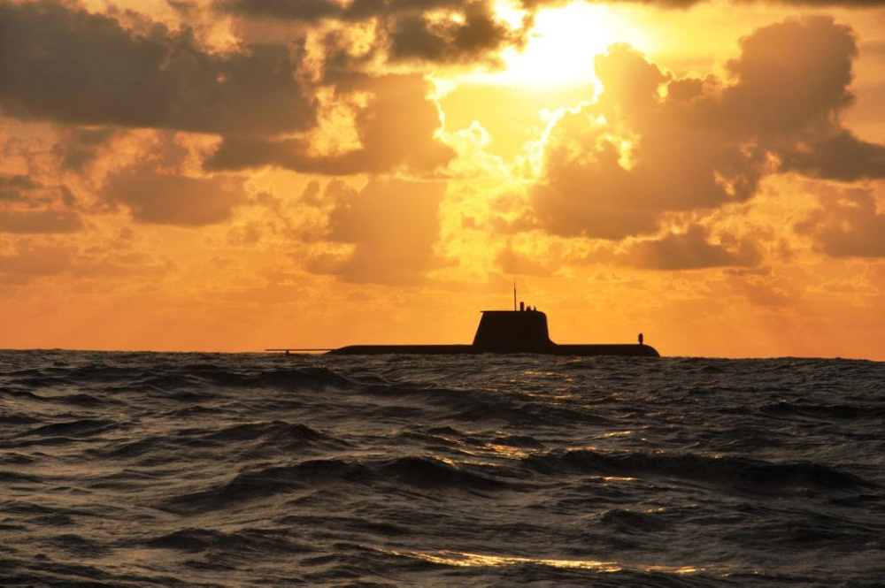 The Royal Australian Navy Collins Class Submarine HMAS Sheean at sunset during a routine transit and training exercise off Christmas Island.