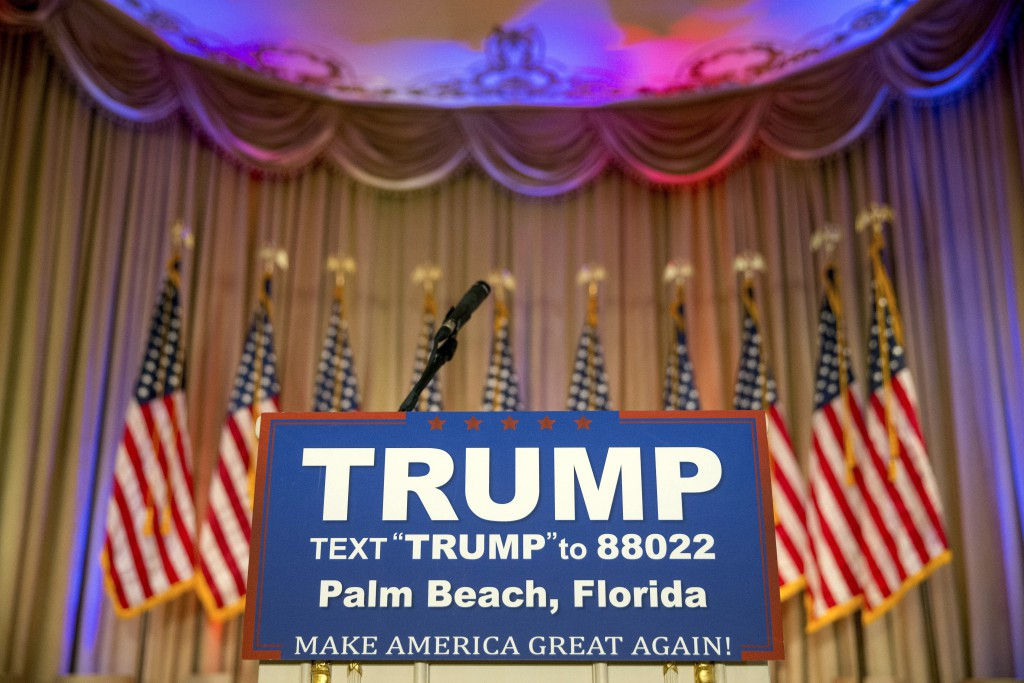 The podium where Republican presidential candidate Donald Trump will speak on Super Tuesday primary election night at the White and Gold Ballroom at The Mar-A-Lago Club in Palm Beach, Fla., Tuesday, March 1, 2016. (AP Photo/Andrew Harnik)