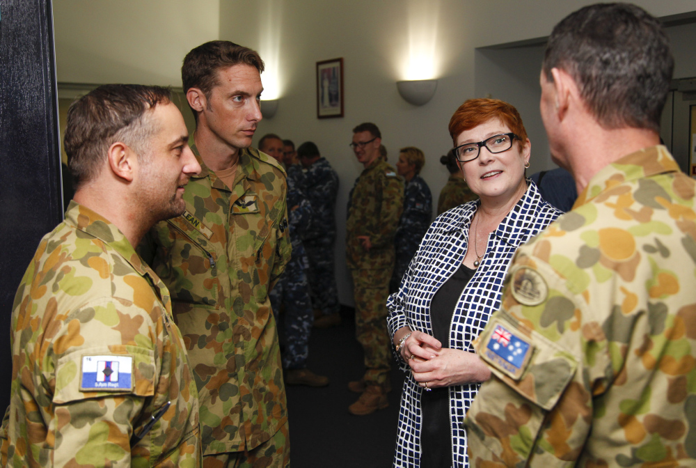 Minister for Defence, Senator the Honourable Marise Payne talks with members of 5th Aviation Regiment on RAAF Base Townsville. *** Local Caption *** Minister for Defence, Senator the Honourable Marise Payne visited RAAF Base Townsville on 22 April 2016. Senator Payne met with RAAF Townsville's head of resident units and discussed their capabilities and current achievements within the ADF.