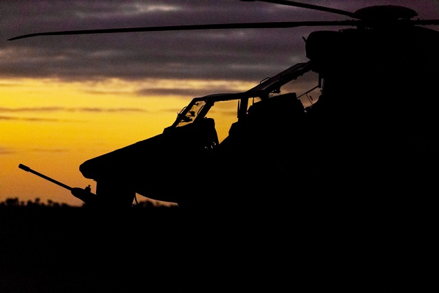 An Australian Army Tiger armed reconnaissance helicopter from 1st Aviation Regiment sits in Battlegroup Griffin's position at Port Pirie, South Australia, on 2 July 2016 during Exercise Hamel. *** Local Caption *** The Australian Army's 1st Brigade is being tested from 26 June to 14 July 2016 in South Australia as part of Exercise Hamel to ensure its soldiers are ready to meet the Australian Government's needs as the Australian Defence Force's 'ready' brigade. Battlegroup Griffin is a multirole Army aviation battlegroup made up aircrew and technicians and Tiger armed reconnaissance helicopters from 1st Aviation Regiment, and MRH-90 Taipan and CH-47F Chinook helicopters from 5th Aviation Regiment. Royal Australian Air Force personnel from the 3rd Security Forces Squadron are attached to Battlegroup Griffin for Exercise Hamel to provide intrinsic airfield security. Army uses the 'Road to Hamel' to build up its next ready brigade and Exercise Hamel is the final test. In 2016, Darwin's 1st Brigade is being put through its paces to ensure it is ready to support operational contingencies ranging from humanitarian assistance through to major combat operations. Exercise Hamel 2016 involves 8000 military personnel from the Australian Army, Royal Australian Navy, Royal Australian Air Force, United States Marine Corps, United States Army and the New Zealand Army. For the first time, Exercise Hamel is being conducted in South Australia and will take place around Port Augusta, Port Pirie, Whyalla and the Cultana training area.
