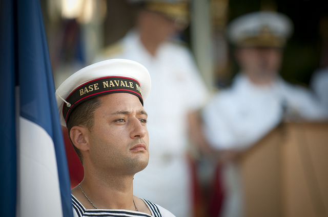 110704-N-CZ945-520 NOUMEA, New Caledonia (July 4, 2011) A sailor of the French navy holds the flag of France for a wreath laying ceremony in commemoration of the Fourth of July and in memory of the American presence in New Caledonia during World War II. U.S. 7th Fleet command ship USS Blue Ridge (LCC 19) and embarked staff are underway on patrol in the 7th Fleet area of responsibility, and are in New Caledonia for a port visit. (U.S. Navy photo by Mass Communication Specialist 2nd Kenneth R. HendrixReleased)