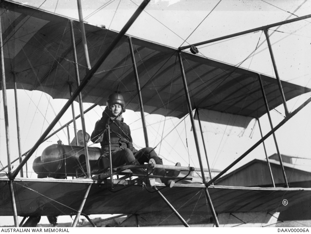 Informal portrait of trainee pilot Captain (Capt) Thomas Walter White, Australian Flying Corps (AFC) at the controls of a Bristol Boxkite at the Central Flying School, Point Cook, Victoria. c.1915